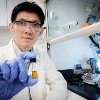 NTU SPMS Asst Prof Soo Han Sen with the plastic-photocatalyst mixture. Photo courtesy of Lester Kok, NTU